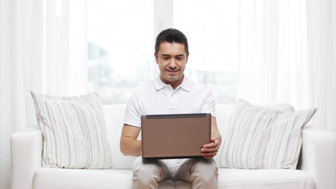 happy man working with laptop computer at home Footage
