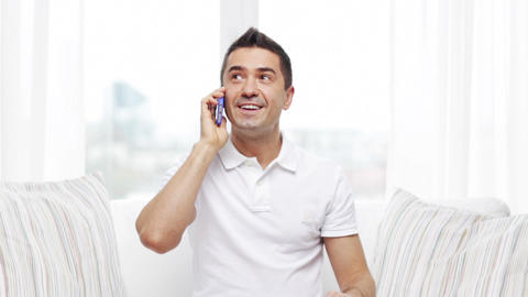 happy man calling on smartphone at home Footage