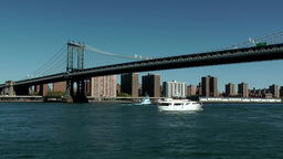 New York City 587 white boat under Manhattan Bridge Footage