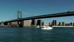 New York City 587 white boat under Manhattan Bridge Footage