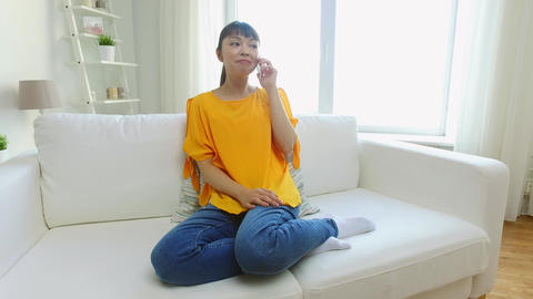 happy asian woman calling on smartphone at home Footage
