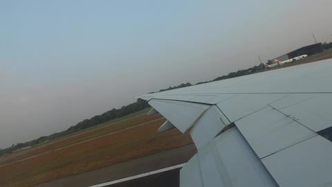 wing of airplane landing on airport runway Footage