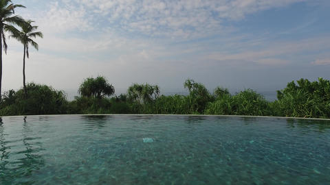 view from infinity edge pool to ocean and palms Footage