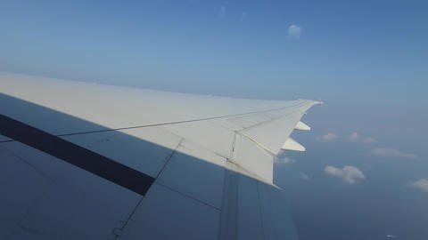 wing of airplane flying in blue sky Footage