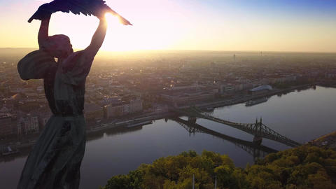 Flying away of Statue of Liberty on Gellert Hill with Liberty Bridge Footage