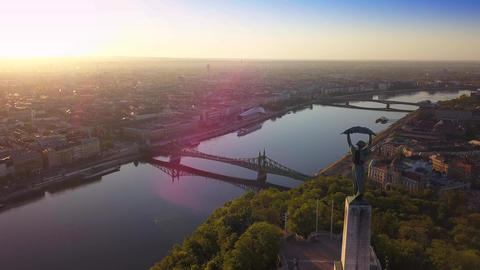 Flying by Statue of Liberty on Gellert Hill with Liberty Bridge at background Footage