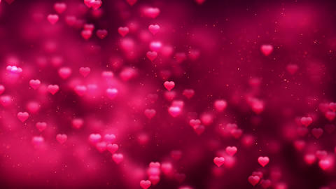 Red love heart Romantic Spinning Dangling Glowing Love Hearts colored Particles CG動画素材