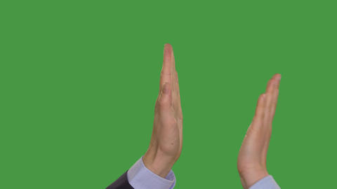 Businesspeople giving high five, keyed green screen Footage