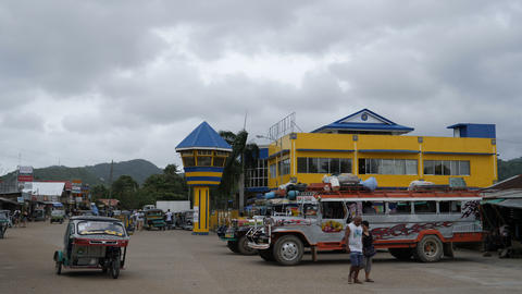 Jeepneys and tricycles at bus terminal Taytay, Palawan, Philippines Footage
