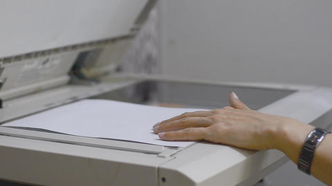Girl scans document in the copier Footage
