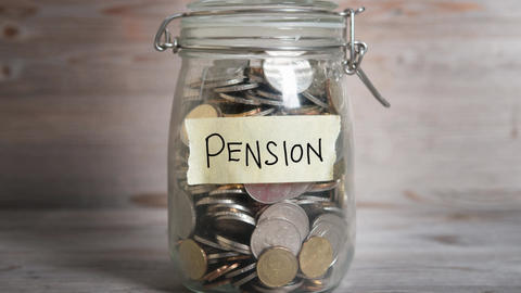 Money jar with pension label Footage