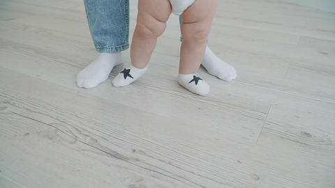 Happy little baby making first steps Footage