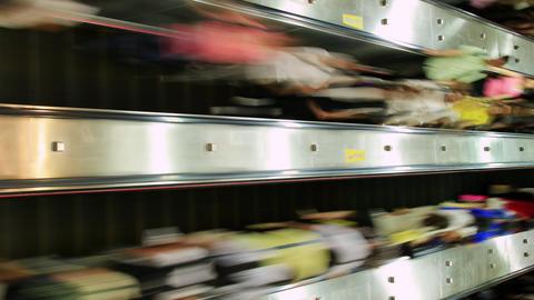 People Zoom Past On Escalators GIF