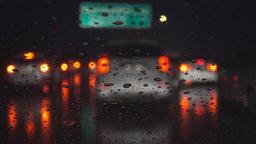 Driving on dark rainy night, rack focus Footage