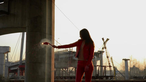 Elegant woman in red costume holds burning smoke flare Footage