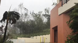 very strong hurricane, the wind tears the roof from the house Footage
