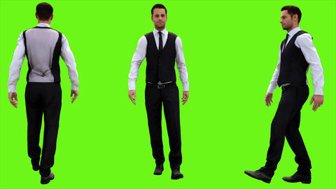 Young businessman walking on a green screen background. Looped animation. 4k Animation