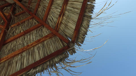 palapa or bungalow straw shed over blue sky Live Action