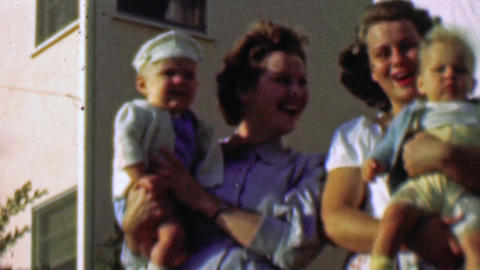 1957: Neighbor baby boomers mothers newborn boys better competition Footage
