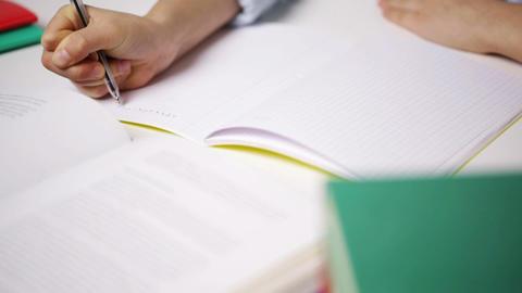 school girl writing math task to notepad Footage