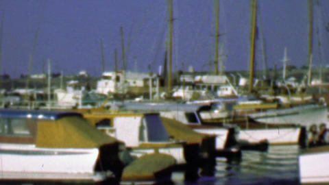 1958: Wood paneled yacht boats in harbor marina docking waters Footage