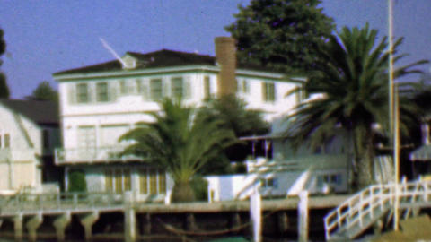 1958: Wealthy waterfront residential homes private docks boats Footage