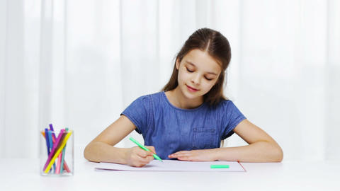 happy girl drawing with felt-tip pens at home Footage