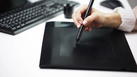 businesswoman or designer drawing with pen tablet Footage
