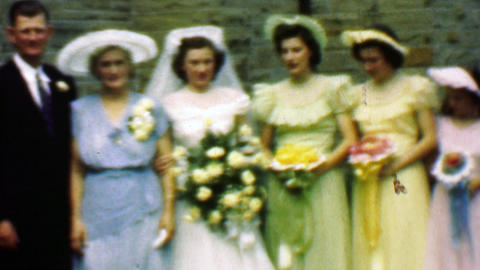 1961: Wedding party rainbow colorful bridesmaids dress outdoor pose Footage