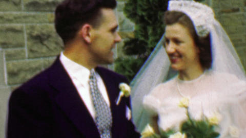 1961: Happy wedding couple excited outside stone classic church Footage