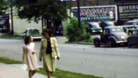 1961: Mother daughter sidewalk classic 1950s cars summer suburban Footage