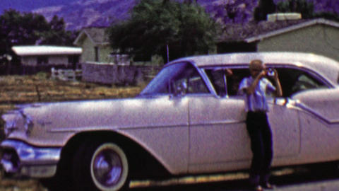 1962: Pink cadillac car roadside stop kid celebrates epic photo Footage