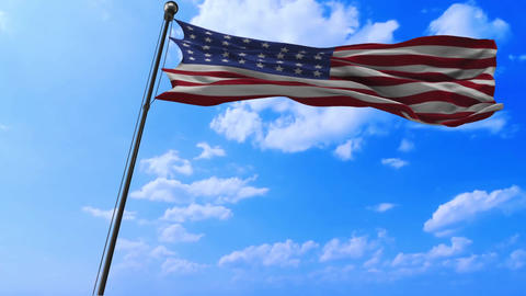 Waving American flag on a blue sky Footage