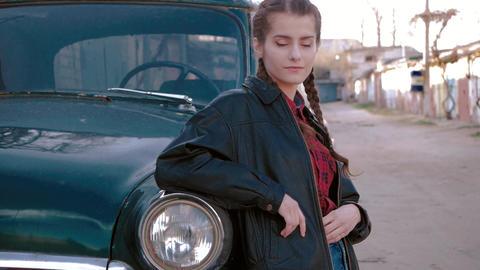 fashion portrait of beautiful sexy woman model girl posing standing near old car Footage