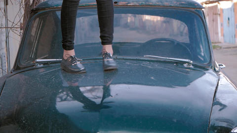 girl dancing on car hood. focus on the legs 영상물