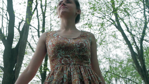 Young beautiful woman walking forest among the trees.... Stock Video Footage