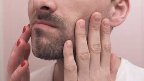 Male and female hands touch the face after shaving Footage