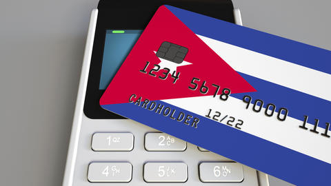Payment or POS terminal with credit card featuring flag of Cuba. Cuban retail Footage