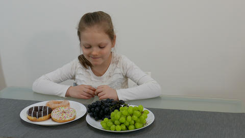 Young Girl Making Choice Between Healthy And Junk Food 002 Footage
