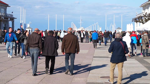 Poland people walk by the famous wooden pier in Sopot, Poland Live Action