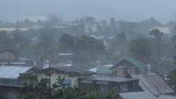 strong hurricane over the city, broken roofs Footage