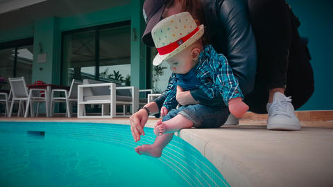 Cute Baby Boy Discovering The Water at The Pool Footage
