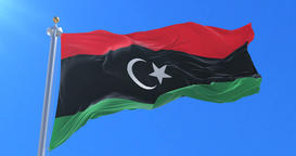 Flag of Libya waving at wind with blue sky in slow, loop Animation
