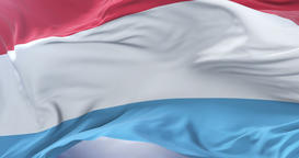 Luxembourg flag waving at wind with blue sky in slow, loop Animation