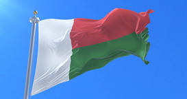 Madagascar flag waving at wind in slow in blue sky, loop Animation