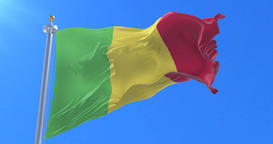 Flag of Mali waving at wind with blue sky in slow, loop Animation