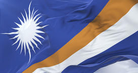 Flag of the Marshall Islands waving at wind in slow with blue sky, loop Animation