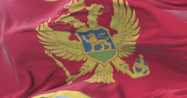 Montenegro flag waving at wind with blue sky in slow, loop Animation