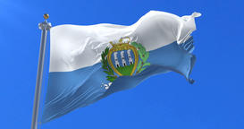 Flag of San Marino waving at wind in slow with blue sky, loop Animation
