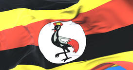 Uganda flag waving at wind in slow with blue sky, loop Animation